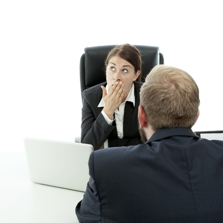 beard business man brunette woman at desk is bored while talking