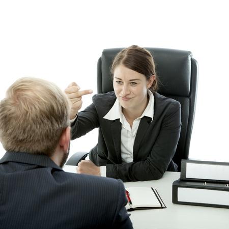 obscene: beard business man brunette woman at desk show middle finger