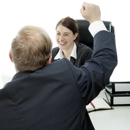 beard business man brunette woman at desk raise arms in the air photo