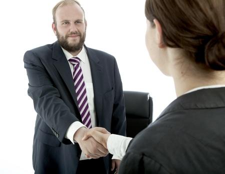 beard business man brunette woman  desk handshake photo