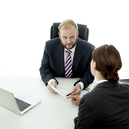 beard business man brunette woman at desk signing contract