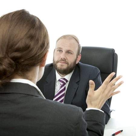 beard business man brunette woman at desk reports Stock Photo
