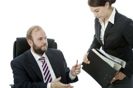 beard business man brunette woman at desk giving files photo