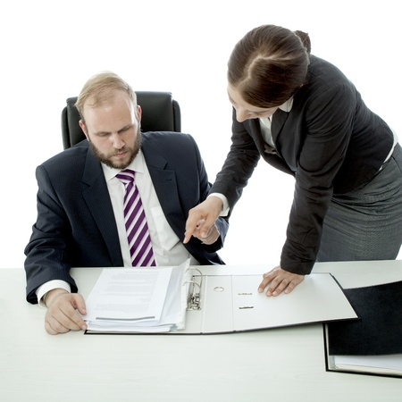 beard business man brunette woman at desk show documents photo