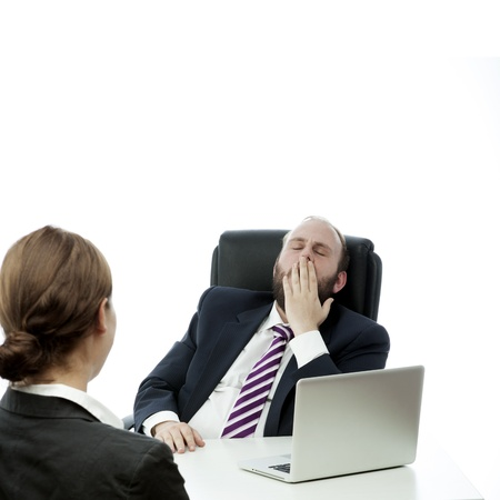 beard business man brunette woman desk yawn