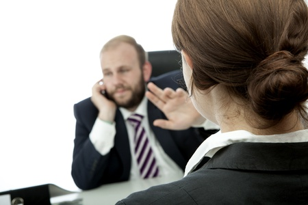 unkind: beard business man brunette woman at desk sign be quiet Stock Photo