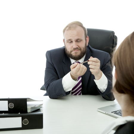 beard business man brunette woman at desk file nails ignore woman Stock Photo