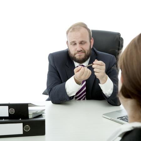 beard business man brunette woman at desk file nails ignore woman Stock Photo