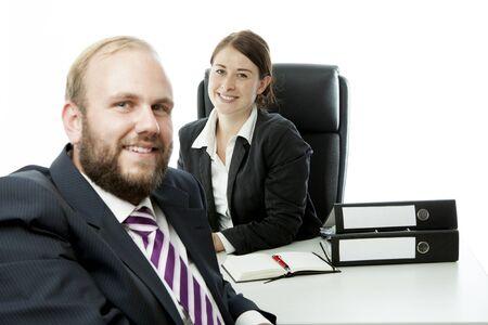 beard business man brunette woman at desk smiling photo