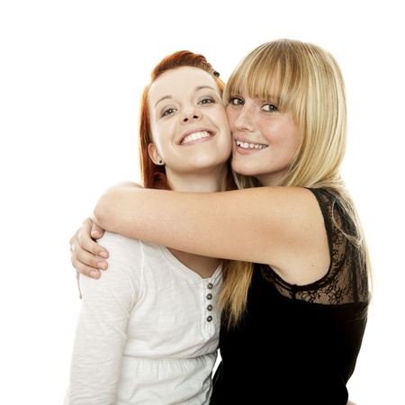young beautiful red and blond haired girls in front of white background