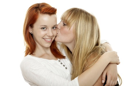 cheeks: young beautiful red and blond haired girls in front of white background