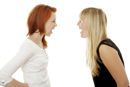 angry blonde: young beautiful red and blond haired girls in front of white background