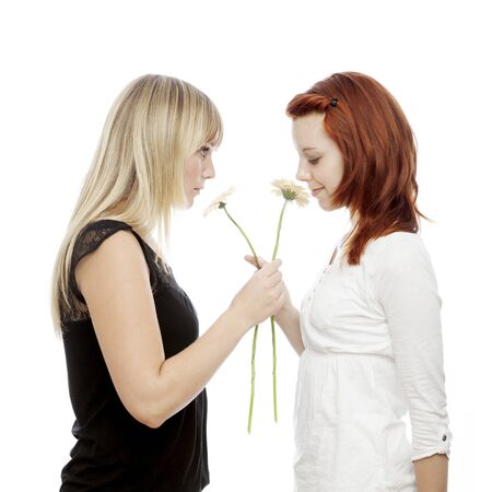 young beautiful red and blond haired girls in front of white background photo