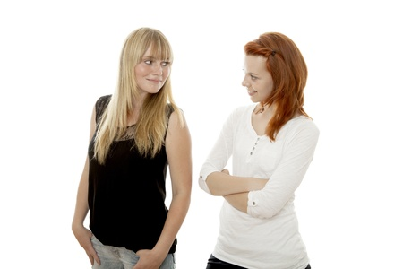 young beautiful red and blond haired girls like each other in front of white background photo