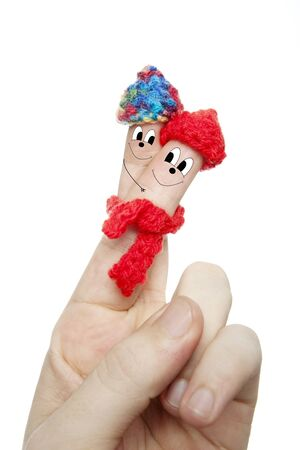 loveley finger with face illustration and hat scarf in front of white background isolated close up Standard-Bild