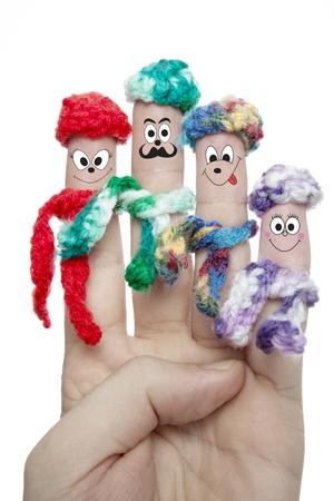 mooie vinger met gezicht illustratie en hoed en sjaal voor witte achtergrond geà ¯ soleerd close-up Stockfoto