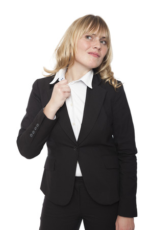 uncomfortable: Uncomfortable businesswoman pulling at her collar either in discomfit at the fit of her shirt or because she is nervous, isolated on white