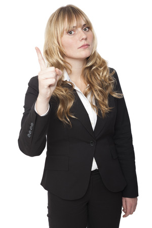 emphasise: Stern beautiful young businesswoman with long blond hair delivering a reprimand raising her finger in the air to emphasise a point, isolated on white