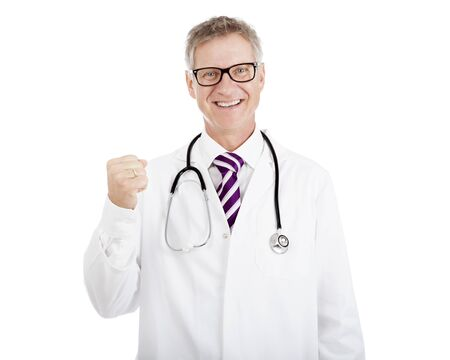 Smiling Doctor Wearing Scrub Suit and Glasses Showing Successful Closed- Fist Hand While Stethoscope on Shoulders. Isolated on White Standard-Bild
