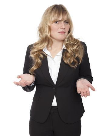 Young businesswoman shrugging her shoulders in ignorance, to show she does not know the answer and could not care. photo