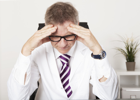 doctor stress: Medical Doctor Suffering Serious Headache from Stress