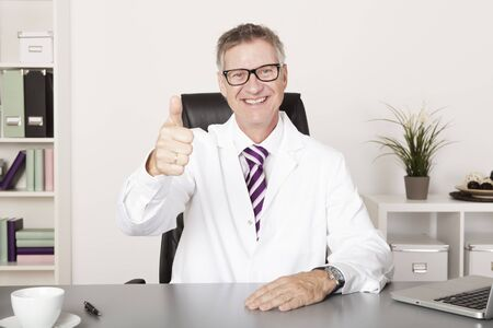 well done: Happy Medical Doctor Showing Thumbs up at Hand Emphasizing Well Job Done