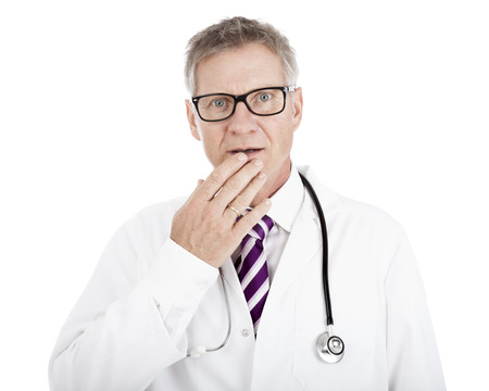 White Doctor in Glasses with Stethoscope on Shoulders Touching his Lip While in Doubt, Isolated on White Standard-Bild