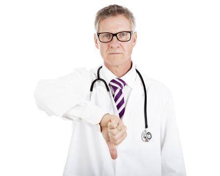 Serious Male Doctor Giving Thumbs Down Sign, Showing Failed Operation Result, Isolated on White Background
