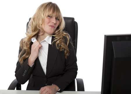 Frustrated businesswoman loosening her collar with a grimace as the heat or pressure and tension get to her, on white photo