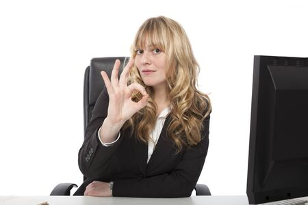 Businesswoman giving a perfect gesture with her fingers as she shows her approval and appreciation, on white photo