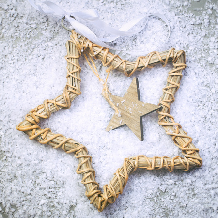 Christmas star on the snow and grey background photo