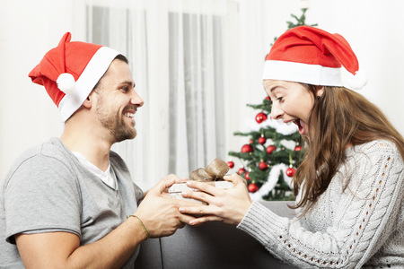 young girl is happy and excited about the gift of her boyfriend Standard-Bild
