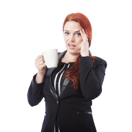 young business woman is tired and nearly fall asleep with coffee in her hand, isolated on white background photo