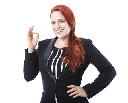 young beautiful business woman sign perfect or okay, isolated on white background photo