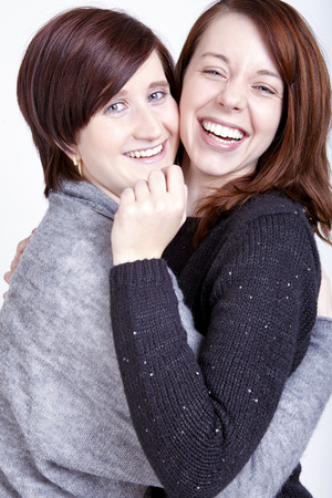 two pretty girls friends having fun and smiling and hug photo
