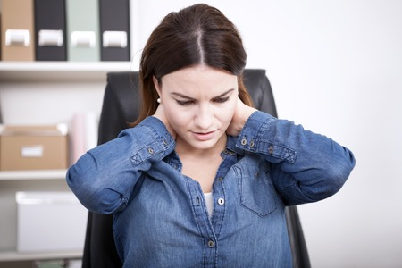 Close up Tired Office Woman in Denim Blouse Holding the Back of her Neck and Rubbing it Slowly Standard-Bild