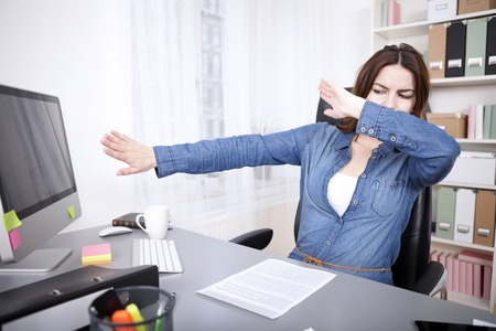 no mistake: Stressed businesswoman reaching breaking point covering her eyes and pushing her computer monitor away with her hands