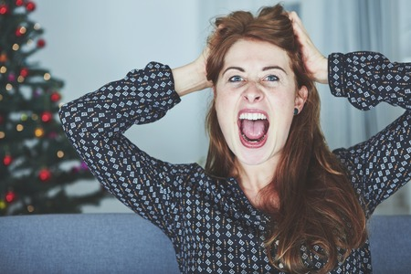 christmas spending: young girl screams because of bad christmas stress Stock Photo