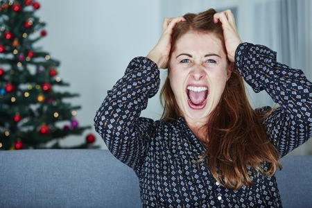 young girl screams because of bad christmas stress Standard-Bild