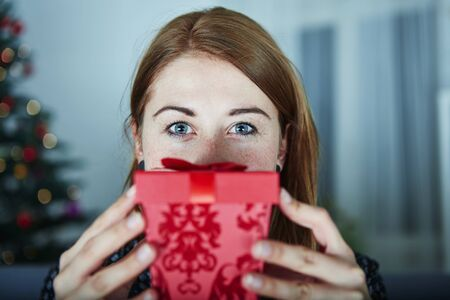 christmas present box: young girl hide behind christmas present box Stock Photo