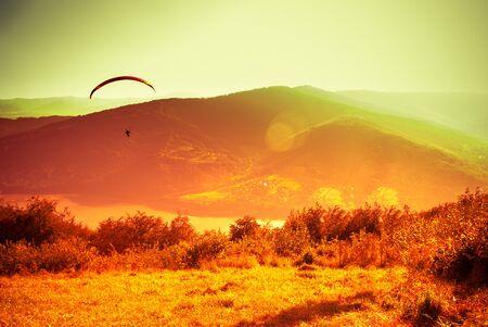 Paraglider flying at Zar Mountain Bielsko