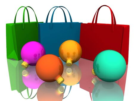 Christmas Balls and Colors shopping bags on white photo
