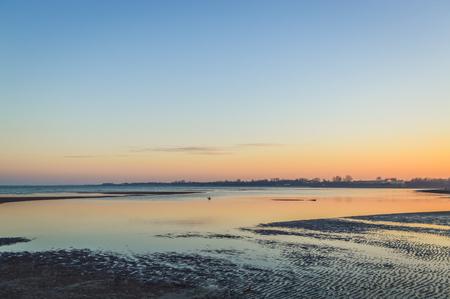sunset on a calm winter sea Stock Photo