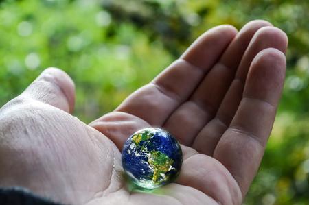 earth handful: earth in hand, human hand holding planet earth