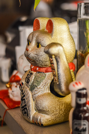 instances: The Maneki Neko is an ancient cultural icon from japan and popular in many asian cultures. The welcoming cat supposedly brings great wealth and fortune to its owner. The cat goes by many names in western cultures, for instances; Welcoming Cat, Lucky Cat,