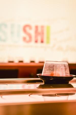 dish on the conveyor belt sushi in a Kaiten Sushi Japanese Restaurant