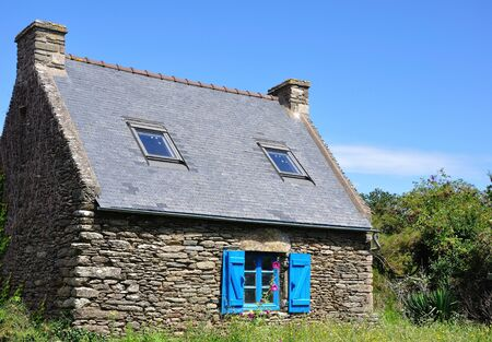 stone house on the island of Groix in summer, France. countryside, sea and calm