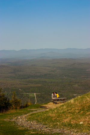 two hikers sitting on a picnic table with a great view Stock Photo