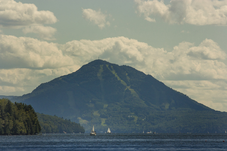 owls head mountain seen from lake memphremagog