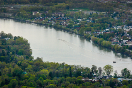 motor boat going through the richelieu river in beloeil quebec Stock Photo